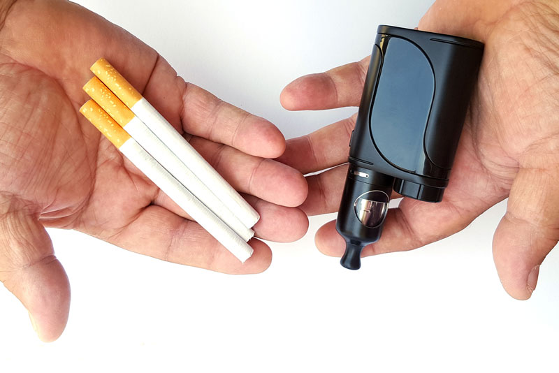 In contrast to traditional cigarettes, e-cigarettes are typically flavored with mint or fruit essences over a liquid containing nicotine, and produce a vapor through an electric heating element.