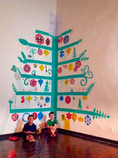 Finding a Christmas tree while living abroad was always a challenge. My sister gave me this idea to paint a 12-foot tree in the corner and we really liked it!