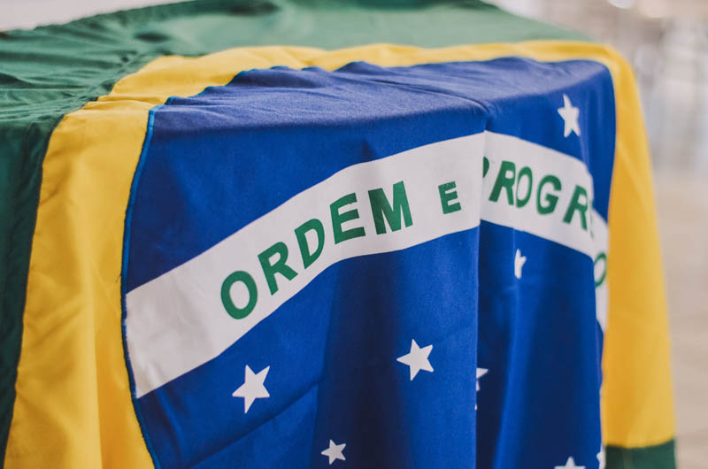 "The Brazilian flag with the national motto ""Ordem e Progresso"" (""Order and Progress"")."